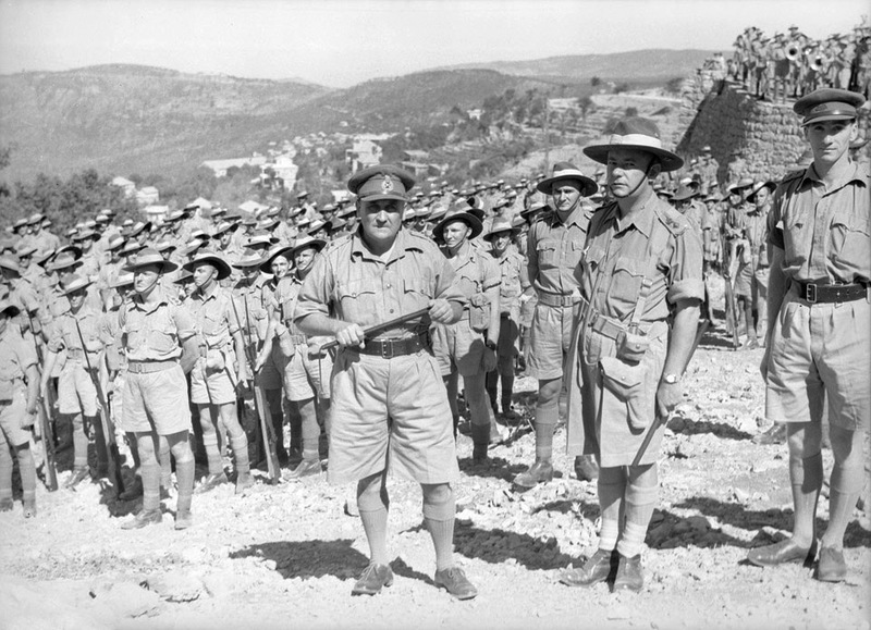 "Hammana, Lebanon. September 2, 1941. Major General A. S. ""Tubby"" Allen (centre), commander of the Australian 7th Division, with Lt Colonel Murray Moten (centre right), commander of the 2/27th Infantry Battalion and his men. (Photographer: Frank Hurley)"